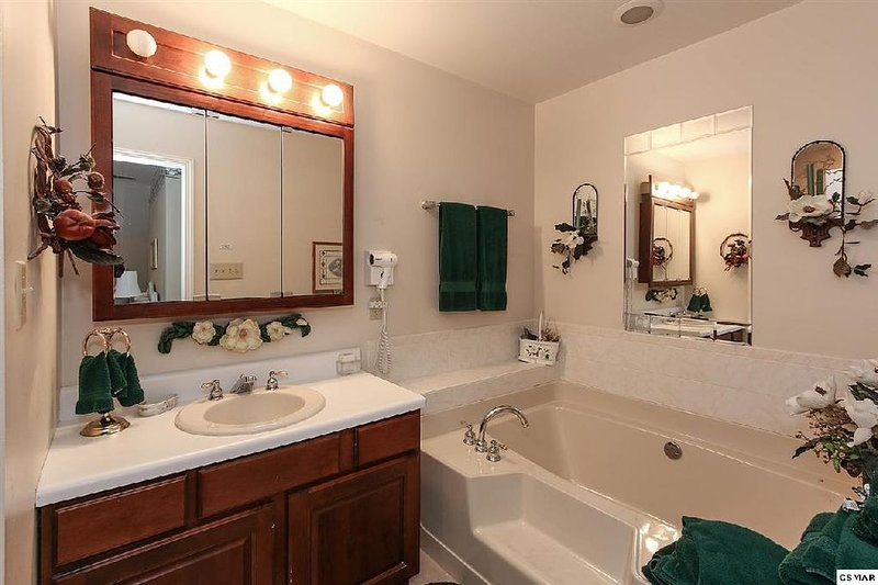 Full bath with shower and garden tub.