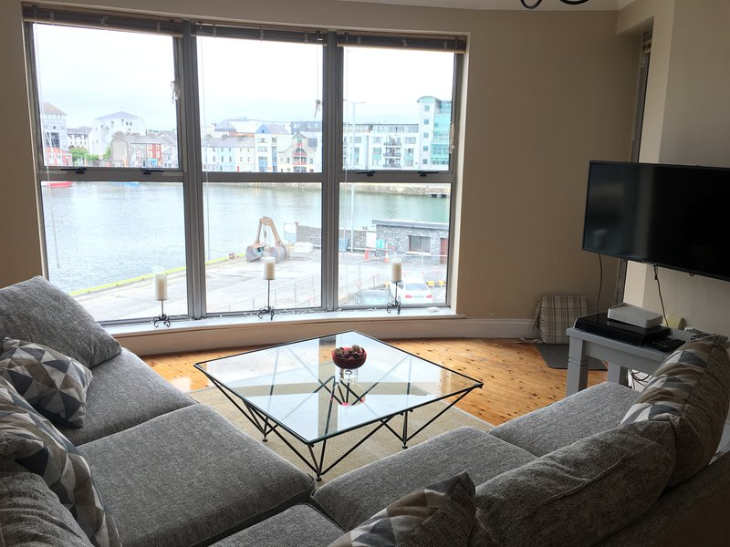 Livingroom with floor to ceiling view over Galway Harbour