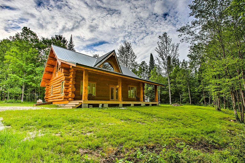 This quaint cabin has all the comforts of home in a secluded, rustic location!