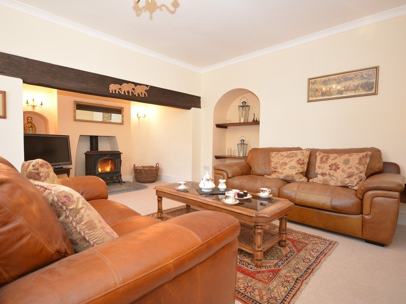 Cosy lounge with comfortable seating and warming wood burner