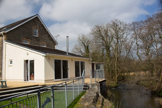 River lounge and River Gwili flowing past