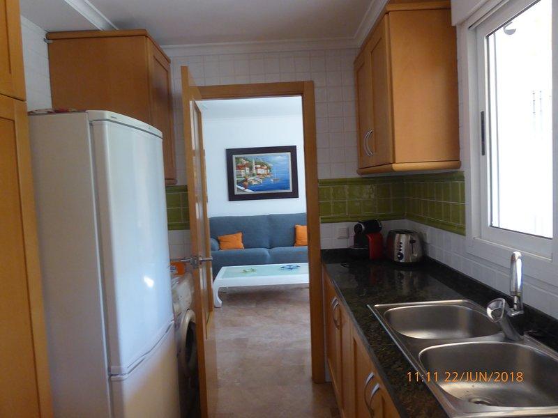 Kitchen with refrigerator, washing machine, toaster and Nespresso machine