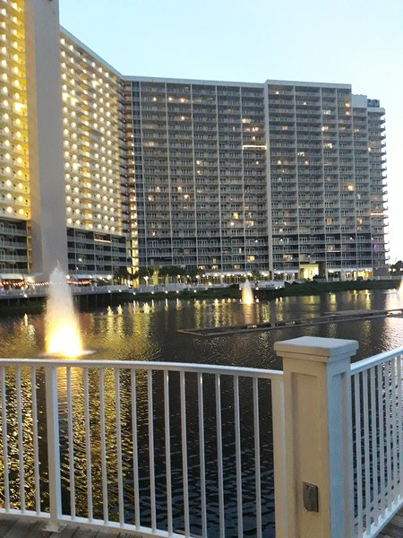 view of Condominium from across private lake