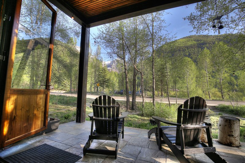 The main living area has an incredible covered patio and incredible mountain views.