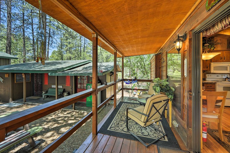 Enjoy the picturesque pine tree views from your private porch!