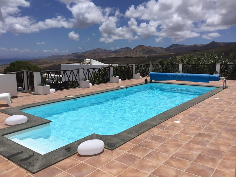 Solar heated pool 4x9 meters with mountain and sea views