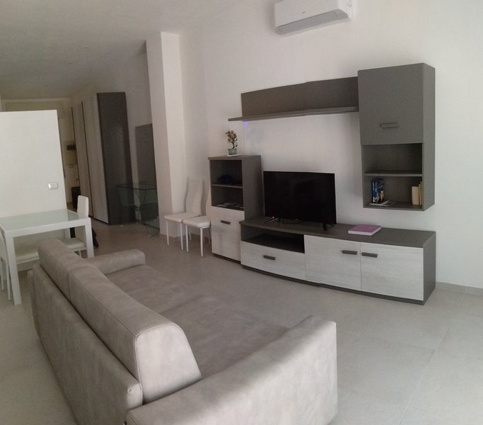 """Ancient House Spa, living room TV 40 """", air conditioning, sofa beds."""