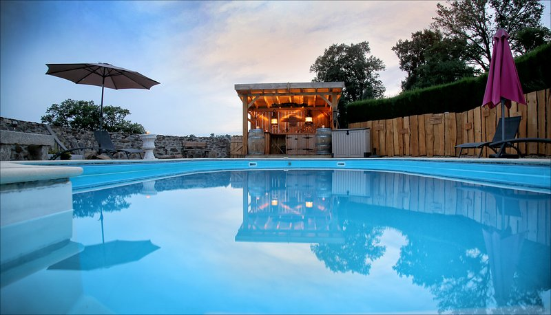 Walled pool area at sunset