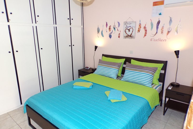 Master Bedroom: Queen size bed, A/C, nightstands, closet