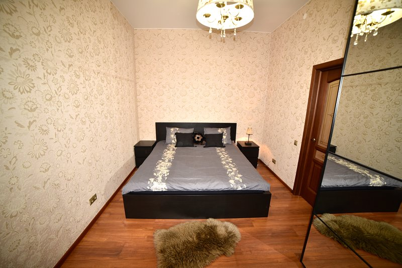 The bedroom with very big bed and orthopedic mattress