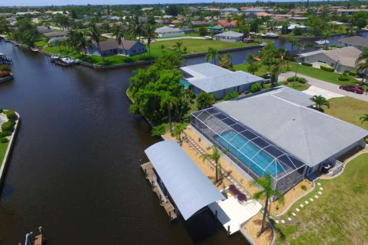 Enjoy a little slice of paradise in this lovely Cape Coral pool home on a direct Gulf access canal.