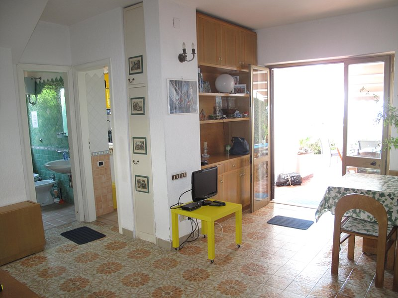 entrance to the LIVING ROOM from the Portico / Terrace overlooking the sea WITH DISINPECTING BATHROOM -DOCCIA and KITCHEN