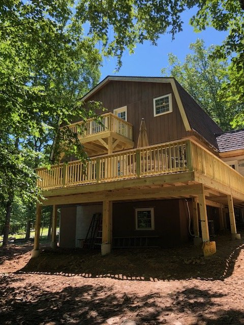 Back of house with new 2 tier deck