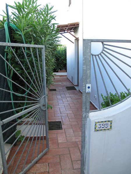 ENTRANCE behind VILLA 399 with fully enclosed access driveway with always green hedge
