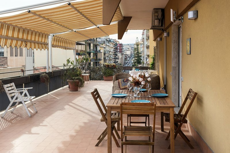 100 sqm terrace, equipped with sofa table and awnings