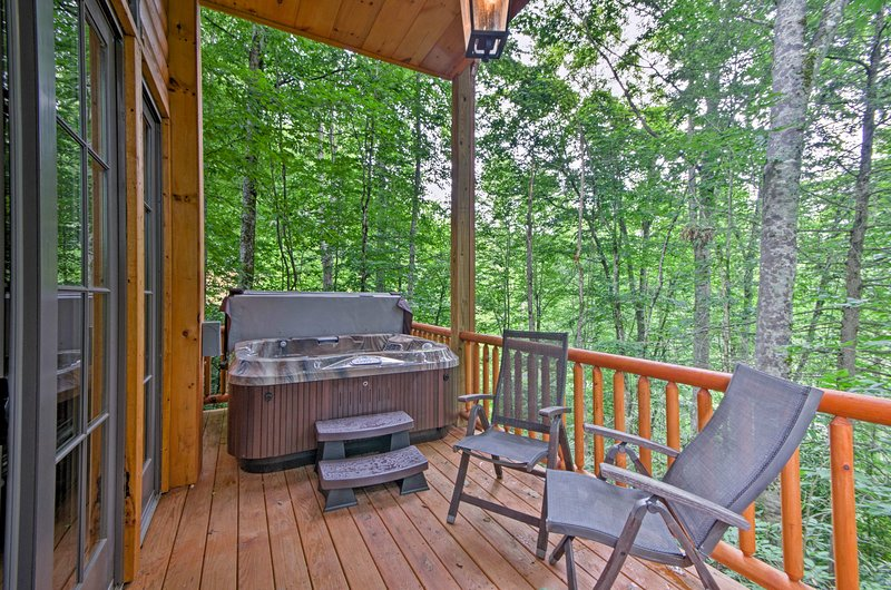 Enjoy the perks of a private hot tub on the back deck.