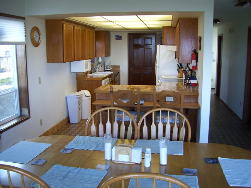 DINING AREA TO KITCHEN WITH SNACK BAR