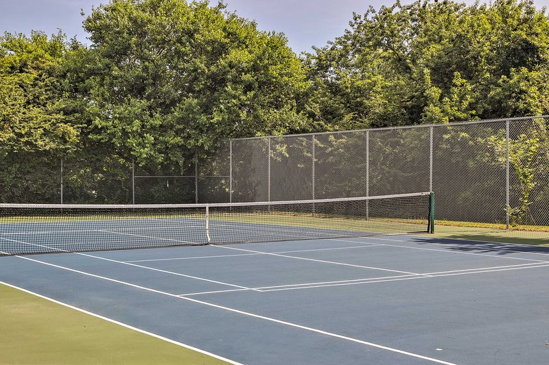 Challenge your fellow guests to a competitive game of tennis!