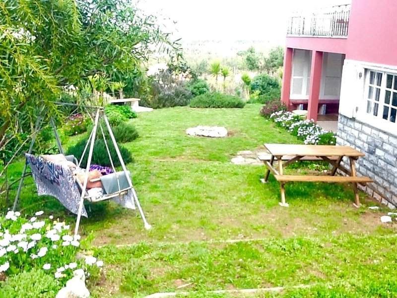 Front garden with BBQ Firepit and hang-out eating area
