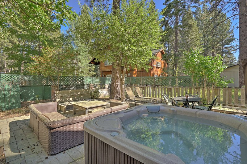 With a fenced-in yard and hot tub, this vacation rental ensures a fun getaway!