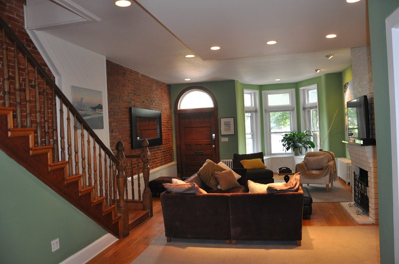 Living room looking towards front door. TV with full cable. Stereo ready