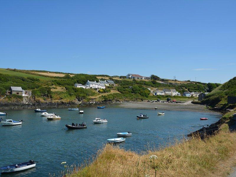 Nearby Abercastle with shingle beach and boats bobbing in the water