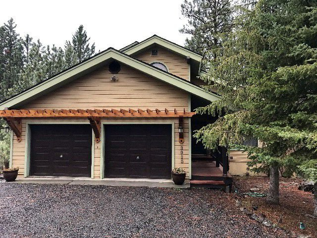 Front entrance to the lodge with ample parking and two car garage.