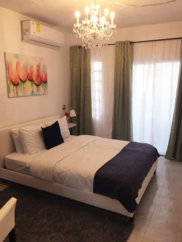 Room room which includes towels and bed linen, bedside table with lamp, and much more!