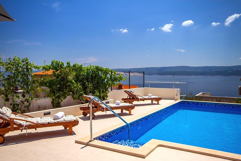 Villa Dasianda con piscina privada climatizada, a solo 90 m del mar