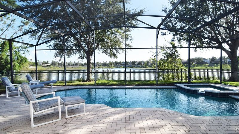 Beautiful south-facing pool deck with lake views