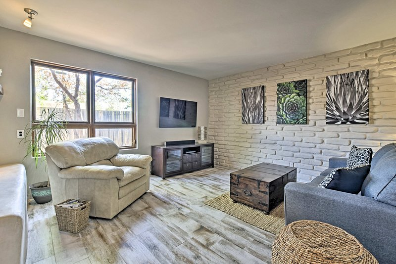 Relax amidst the tasteful decor and white brick accent wall.