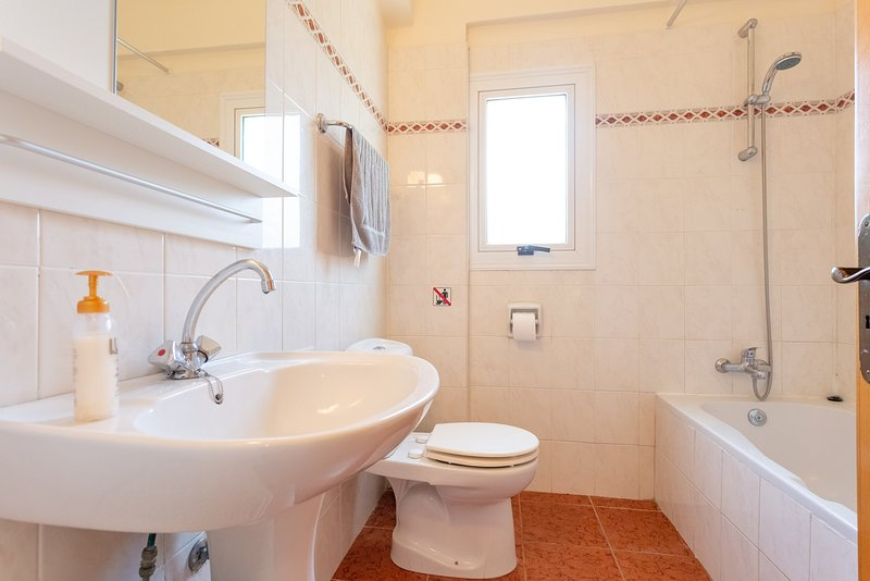 Family bathroom with bath and overhead shower
