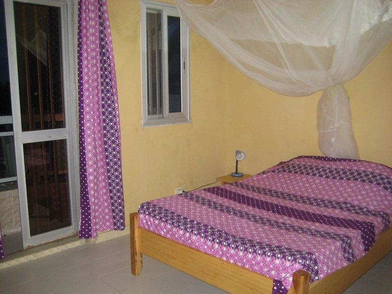 20sqm room with double bed mosquito net, balcony, shower room wc