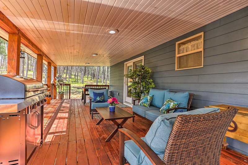 The property features a large yard and spacious decks.