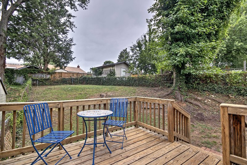 This quaint getaway includes a private deck and backyard.