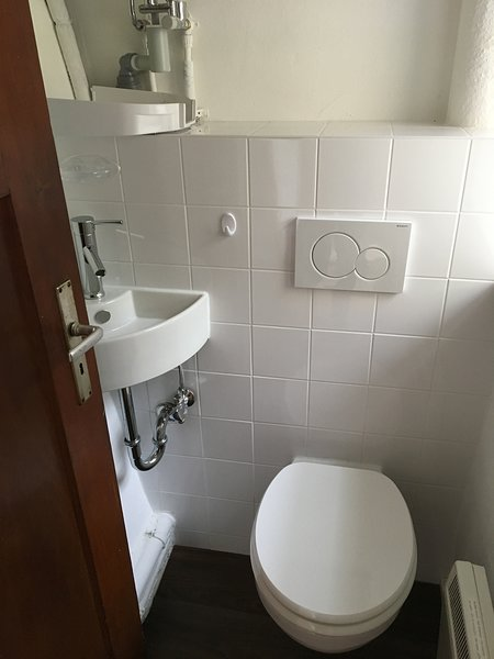 Toilet with hand basin