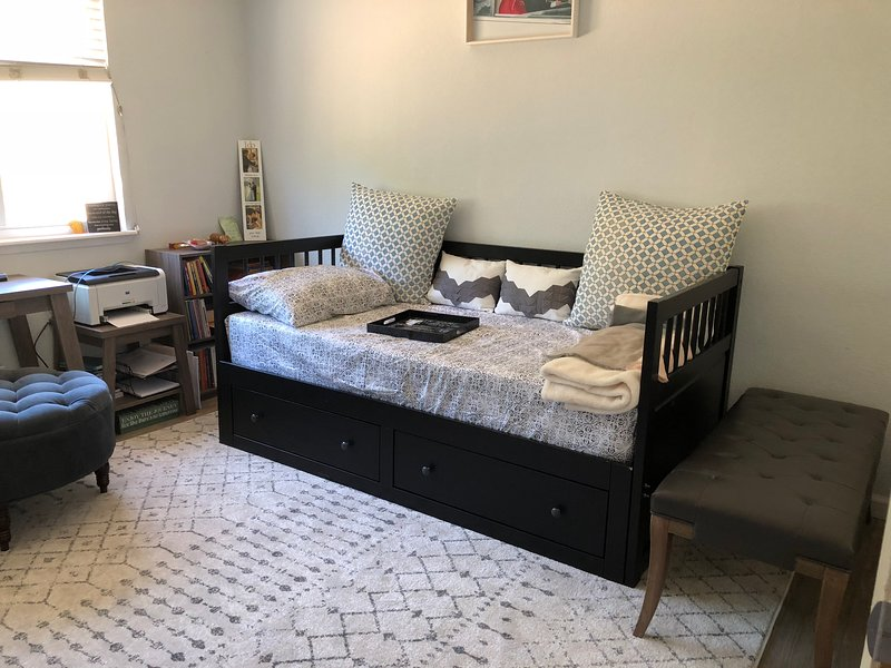 Twin Size bed for 1 guest, bench, and desk