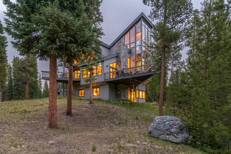 Walls of glass and plenty of deck space help you enjoy the Breckenridge landscape.