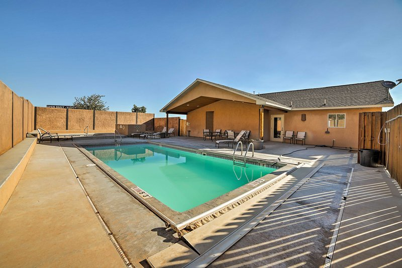Your next Moab vacation rental boasts a sparkling community pool!