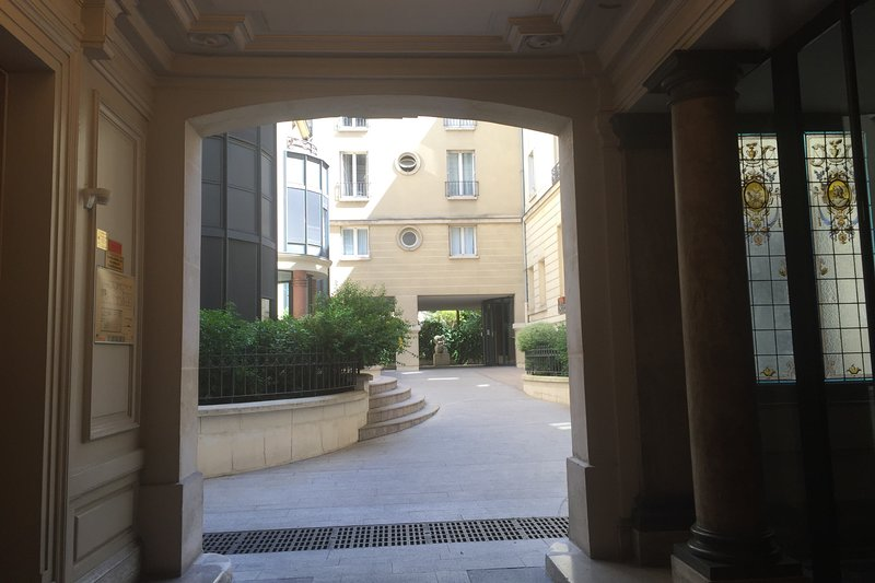 The entrance to the private courtyard and the private gardens behind.