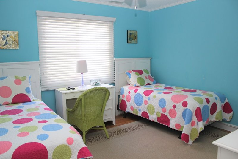streetside bedroom with 2 singles