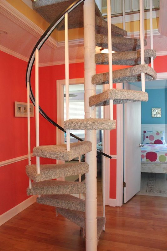 spiral staircase to bottom level bedrooms/bathroom