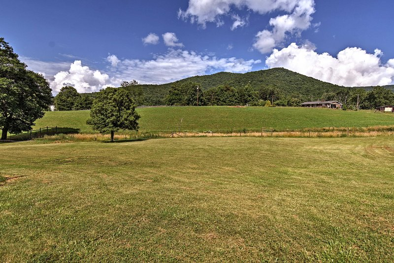 Get away from it all and book this Candler home in the countryside.