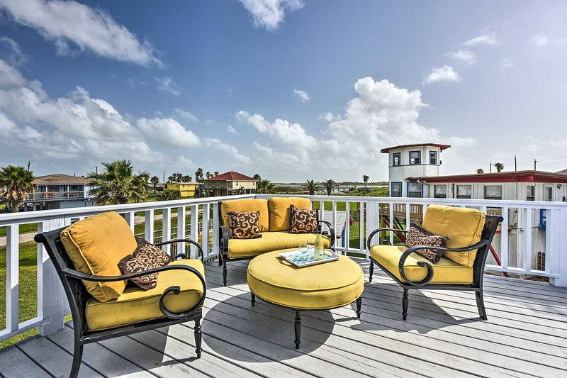 Share a glass of wine on the private balcony while taking in the coastal views.