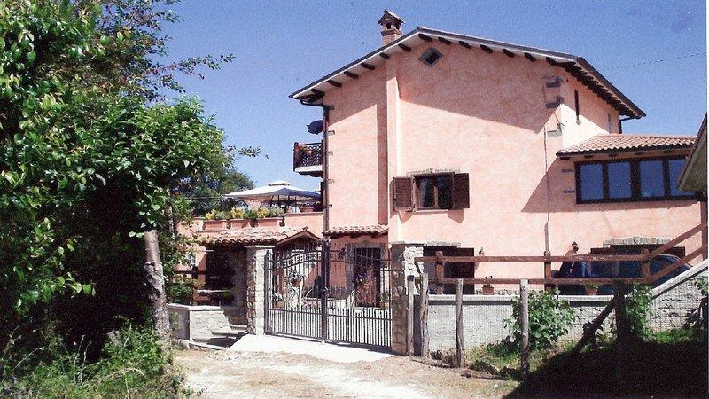 chambre avec balcon et vue sur les montagnes, location de vacances à Posta