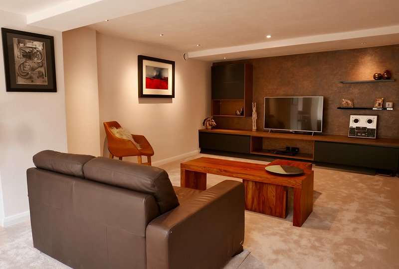 Relax in the beautifully furnished spacious living room with 50' TV.