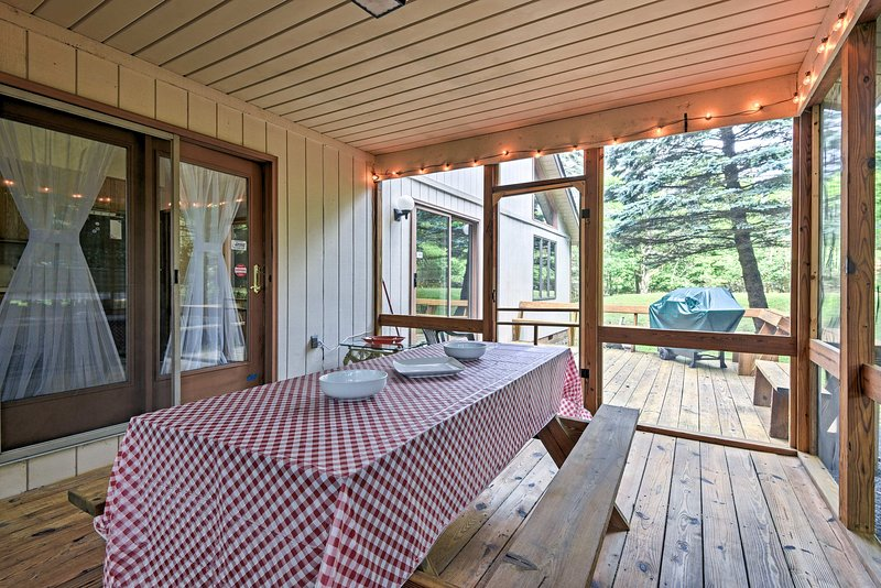 With a screened-in porch and beds for 8,  this home is truly 5 stars.