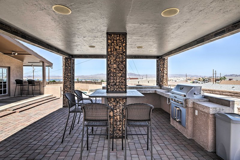 The incredible outdoor space includes a kitchen, pool, and rooftop hot tub!