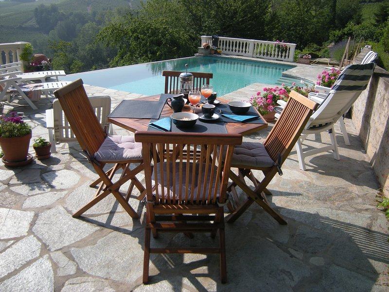 Enjoy breakfast on the pool terrace over looking the vinyards