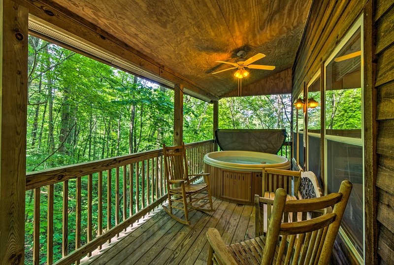 Enjoy the perks of a private hot tub and front porch.